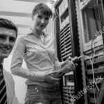 stock-photo-team-of-technicians-using-digital-cable-analyser-on-servers-in-large-data-center-212087590-002