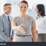 stock-photo-business-people-welcoming-new-staff-to-work-