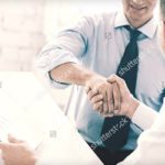 stock-photo-businesss-and-office-concept-two-businessmen-shaking-hands-in-office
