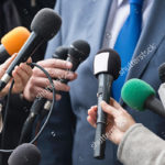 stock-photo-media-interview-group-of-journalists-surrounding-vip
