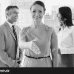 stock-photo-business-people-welcoming-new-staff-to-work
