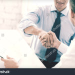 stock-photo-businesss-and-office-concept-two-businessmen-shaking-hands-in-office-229882258