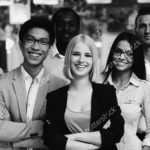 stock-photo-happy-group-of-co-workers-standing-in-office