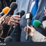 stock-photo-media-interview-group-of-journalists-surrounding-vip-376505077